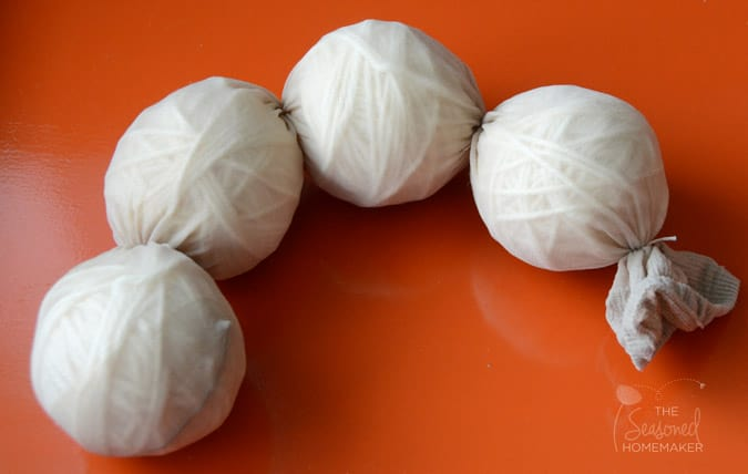 Dryer Balls Tutorial: Learn How to Wool Make Dryer Balls and save money on drying your clothes. Felted Wool Dryer Balls are easy and inexpensive to make. These would make a great gift.