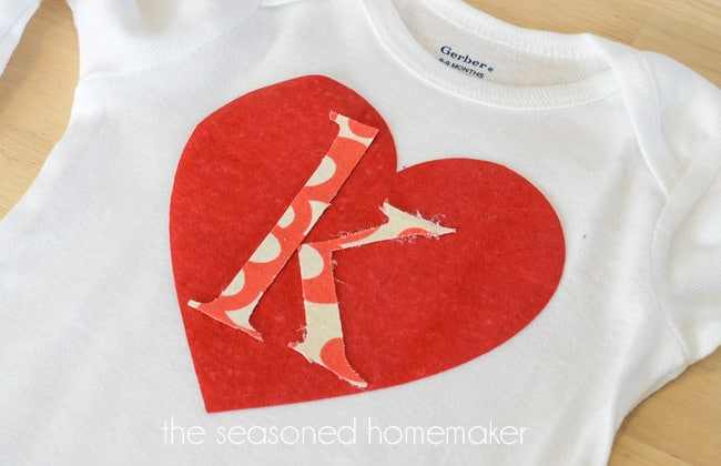 Valentine's Day is the perfect time to sew something fun and easy. This appliqué tutorial shows you step-by-step how to easily recreate a Valentine's Onesie. Sewing one of these projects is sure to brighten anyone's day.