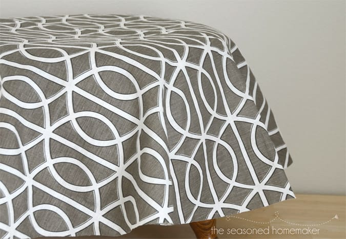 Years ago I inherited this ottoman that needed refurbishing. Find out my fast and easy way to make a DIY slip cover that gave this ottoman a whole new look.