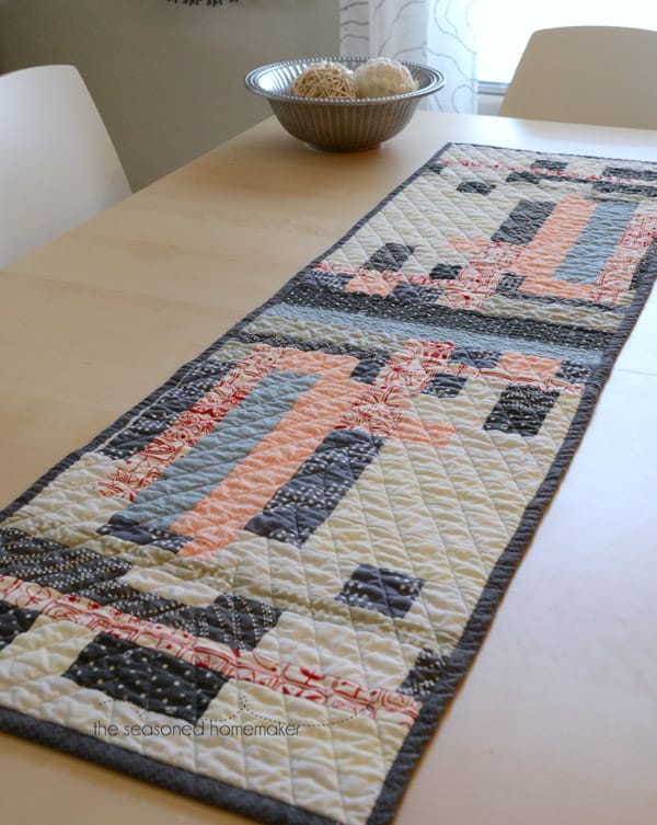 This table runner came about because of a painting I received as a gift. I love the modern geometric design in the painting and was inspired to create this modern quilted table runner using improvisational quilting methods. quilting | modern quilts | improvisational quilts