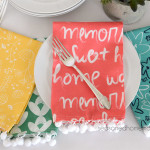Want an easy DIY Sewing Project. Learn how to sew simple cloth napkins with mitered corners. Also included are easy steps to add pom pom trim to your dinner napkins. All you need are a few fat quarters and the ability to sew a straight stitch to complete this popular post.