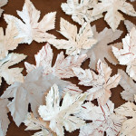 Celebrate Thanksgiving with this simple DIY project using craft store chalk paint and Dollar Store leaves. Simple supplies like a bag of inexpensive leaves, some glue, and a little craft store paint and you can have a lovely DIY Fall table scape on a budget.