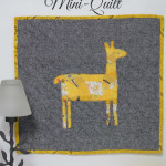 Want a way to use of up those sewing scraps. Applique is an excellent way to embellish a modern quilt. It's ideal for all sorts of sewing projects. If you can sew a straight stitch then you can make Como Se Llama Mini Quilt. The quilt is fast, easy, and can be completed in an afternoon.