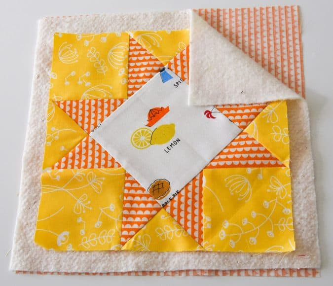 You know that point in a quilting project when you've finished a piecing the top and it's time to add the batting. With so many choices, it's difficult to know which one to choose. 100% Cotton Batting, Cotton/Polyester Blend Batting, Wool Batting, etc. This post will help you choose the right batting for your project.