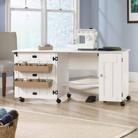 If you love to sew then you probably long for a sewing room. When that isn't an option, the next best thing is a sewing cabinet or sewing table that fits nicely into your home. This collection of sewing tables and sewing cabinets gives you several options to turn an empty corner into your dream sewing room.