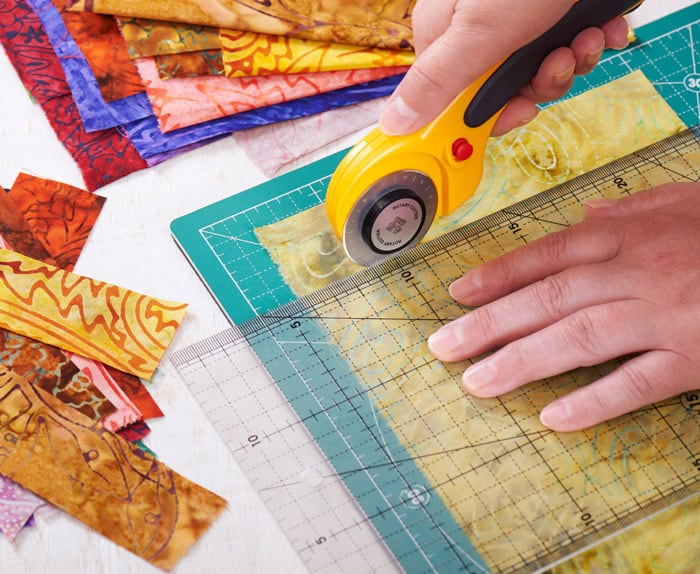The most basic step in Quilting 101 is learning how to use a rotary cutter and mat. Once you've mastered this skill, you're on the road to being a quilter.