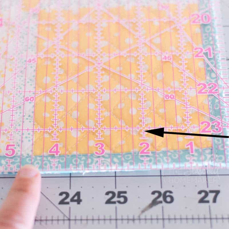 Take your ruler and measure 2.5†(6.4 cm) in from the right side and draw a line. Pin the placemats together so they do not shift while you sew.