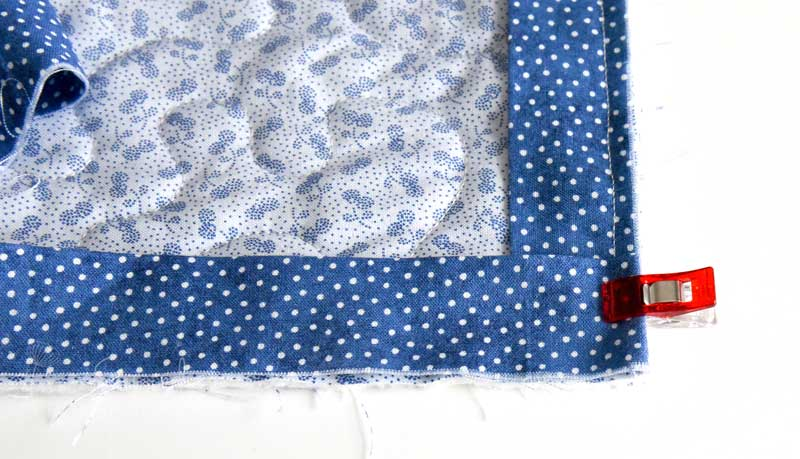 When binding a quilt, Fold the binding back down over the corner