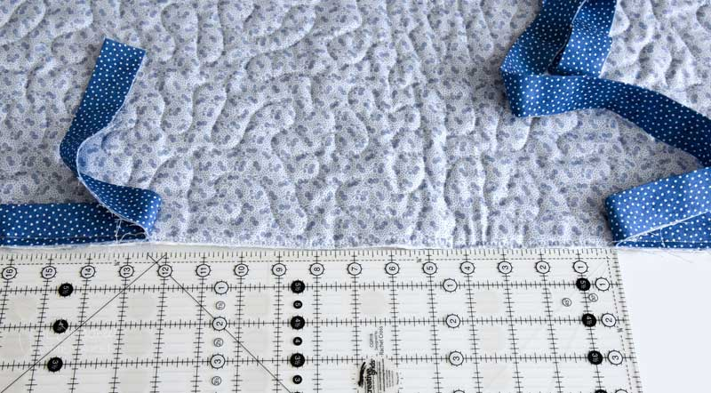 """Continue attaching the binding in this manner until you're about 12"""" from the starting point"""